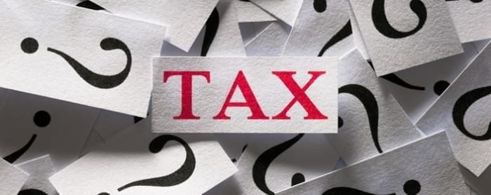 TAX image -- tax text with question marks